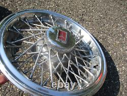 1981 to 1988 Oldsmobile Cutlass wire spoke 14 inch hubcaps wheel covers nice