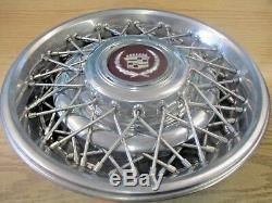 One 1986 to 1992 Cadillac Fleetwood Brougham wire spoke hubcap wheel cover