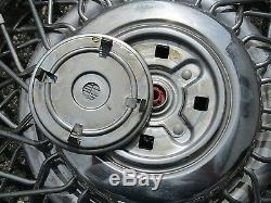 One 1987 1988 Cadillac Deville wire spoke locking 14 inch hubcap wheel cover