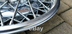 Two 1986 to 1992 Cadillac Fleetwood Brougham wire spoke hubcap wheel covers